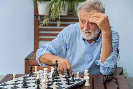 Elderly playing chess in nursing home for leisure Stock Photo