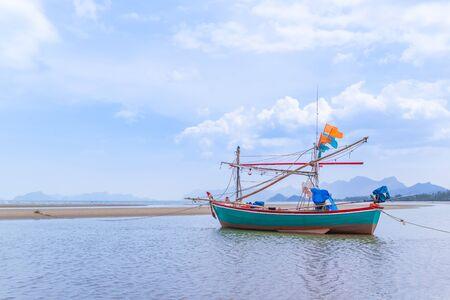 Fishing boat on beach near fisherman village at Khao Kalok mountain, near Hua Hin, Thailand