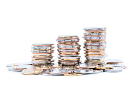 Stack of coins on white background; business, finance, and investment concept