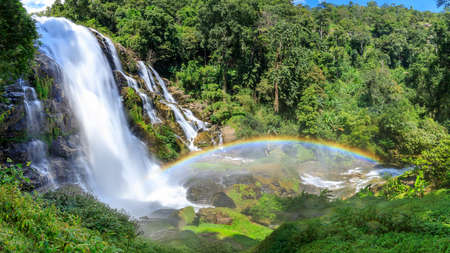Wachirathan Waterfall in Doi Inthanon National Park, one of largest and famous cascade in country with rainbow, Chiang Mai, Thailand, panorama