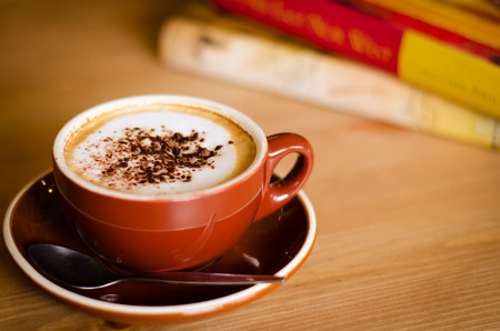 Relaxing Time With A Cup of Cappuccino Coffee. photo