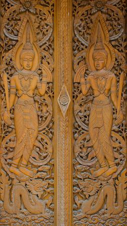 teak: Ancient Golden Teak Carving In Classic Thai Art Style. Stock Photo