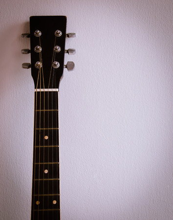 frets: Old Guitar Neck and Frets On Background. Stock Photo