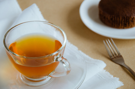 tea break: Glass Cup of Tea and Chocolate Cake for Tea Break.