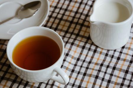 tea break: Tea and Milk for Tea Break. Stock Photo