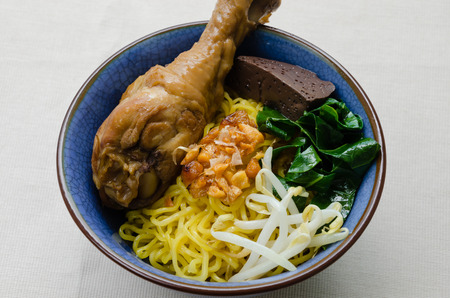 drumstick: Egg Noodle with Stewed Chicken Drumstick.