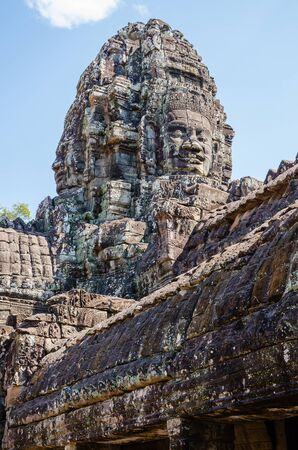 Smiling Faces of Bayon Temple in Angkor Thom is The Heritage of Khmer Empire at Siem Reap Province, Cambodia.