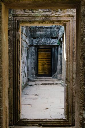 Inside Gate of Bayon Temple in Angkor Thom is The Heritage of Khmer Empire at Siem Reap Province, Cambodia. Foto de archivo - 150111322