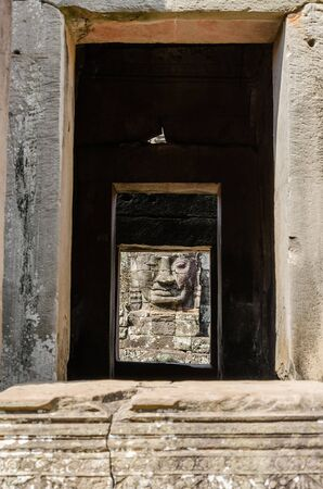Smiling Faces of Bayon Temple in Angkor Thom is The Heritage of Khmer Empire at Siem Reap Province, Cambodia. Foto de archivo - 150111437