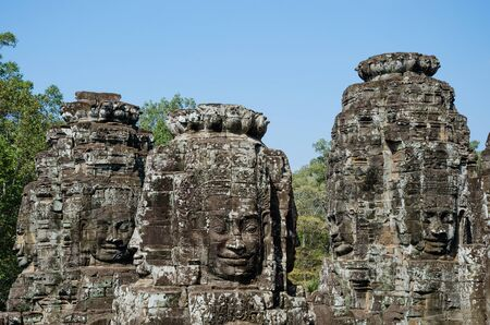 Smiling Faces of Bayon Temple in Angkor Thom is The Heritage of Khmer Empire at Siem Reap Province, Cambodia. Foto de archivo - 150113137