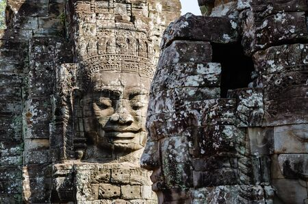Smiling Faces of Bayon Temple in Angkor Thom is The Heritage of Khmer Empire at Siem Reap Province, Cambodia. Foto de archivo - 150113140