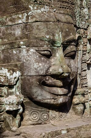 Smiling Faces of Bayon Temple in Angkor Thom is The Heritage of Khmer Empire at Siem Reap Province, Cambodia. Foto de archivo - 150113165
