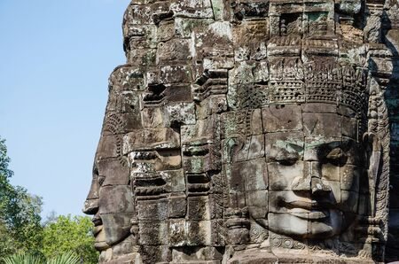 Smiling Faces of Bayon Temple in Angkor Thom is The Heritage of Khmer Empire at Siem Reap Province, Cambodia. Foto de archivo - 150113167