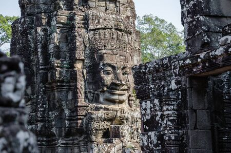 Smiling Faces of Bayon Temple in Angkor Thom is The Heritage of Khmer Empire at Siem Reap Province, Cambodia. Foto de archivo - 150113171
