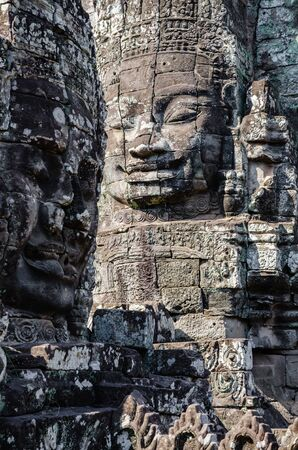 Smiling Faces of Bayon Temple in Angkor Thom is The Heritage of Khmer Empire at Siem Reap Province, Cambodia. Foto de archivo - 150113174