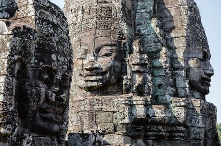 Smiling Faces of Bayon Temple in Angkor Thom is The Heritage of Khmer Empire at Siem Reap Province, Cambodia. Foto de archivo - 150113177