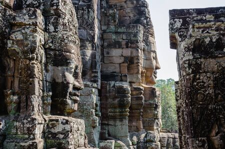 Smiling Faces of Bayon Temple in Angkor Thom is The Heritage of Khmer Empire at Siem Reap Province, Cambodia. Foto de archivo - 150112991
