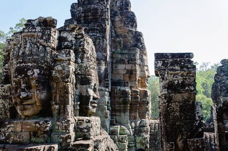 Smiling Faces of Bayon Temple in Angkor Thom is The Heritage of Khmer Empire at Siem Reap Province, Cambodia. Foto de archivo - 150113028