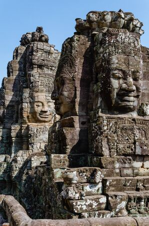 Smiling Faces of Bayon Temple in Angkor Thom is The Heritage of Khmer Empire at Siem Reap Province, Cambodia. Foto de archivo - 150113127