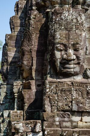 Smiling Faces of Bayon Temple in Angkor Thom is The Heritage of Khmer Empire at Siem Reap Province, Cambodia. Foto de archivo - 150113129
