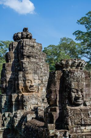 Smiling Faces of Bayon Temple in Angkor Thom is The Heritage of Khmer Empire at Siem Reap Province, Cambodia. Foto de archivo - 150113131