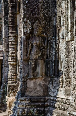 Smiling Faces of Bayon Temple in Angkor Thom is The Heritage of Khmer Empire at Siem Reap Province, Cambodia. Foto de archivo - 150113133