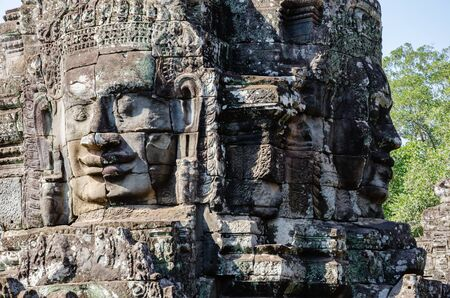 Smiling Faces of Bayon Temple in Angkor Thom is The Heritage of Khmer Empire at Siem Reap Province, Cambodia. Foto de archivo - 150112372