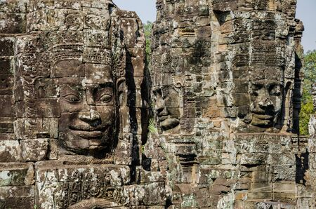 Smiling Faces of Bayon Temple in Angkor Thom is The Heritage of Khmer Empire at Siem Reap Province, Cambodia. Foto de archivo - 150112061