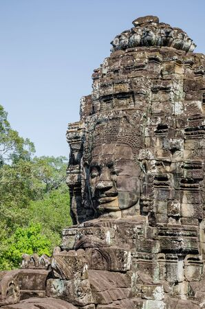 Smiling Faces of Bayon Temple in Angkor Thom is The Heritage of Khmer Empire at Siem Reap Province, Cambodia. Foto de archivo - 150112067