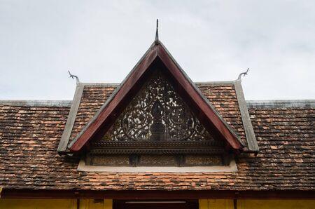 Antique Ceramic Roof of Porch's Gate of Wat Sisaket Monastery is a Landmark of Vientiane Capital City of Laos.