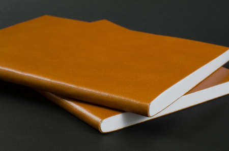 Leather Cover Notebook on Black Background. Foto de archivo