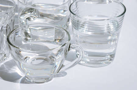 Glass of Drinking Water on Clear White Background. Foto de archivo