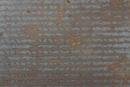 The background of the metal sheet walkway is old and rusty. Zdjęcie Seryjne