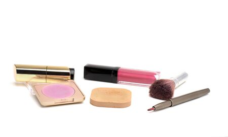 Old used cosmetics placed on a white background
