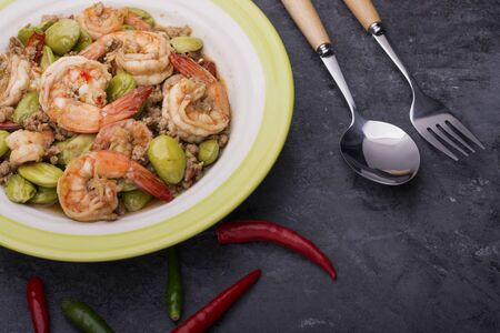 Stir Fried Shrimp with Sato Put the dish beautifully on the black table Is an Asian menu