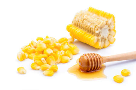 Delicious sweet yellow ripe corn kernels with honey On a white background Archivio Fotografico