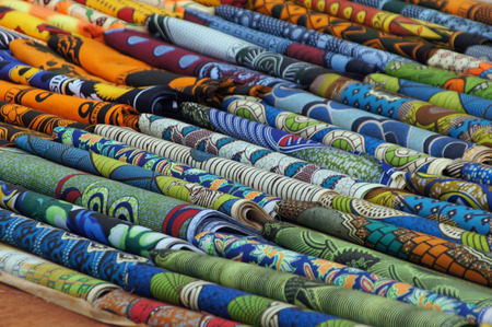 adjacent: Colorful fabrics are adjacent