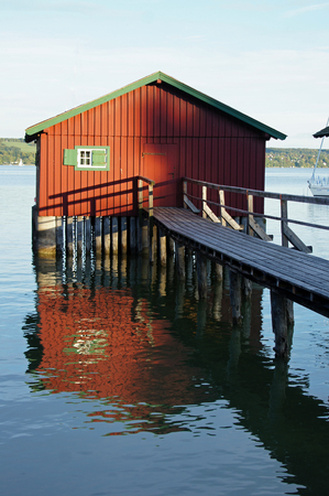 stilt house: Red boathouse on the water