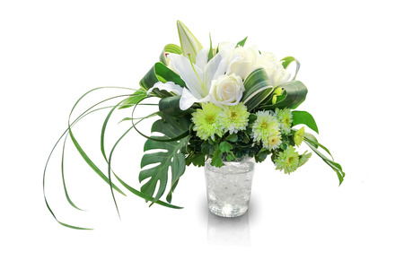 vase of flowers: Bouquet of flowers in a vase on white background Stock Photo