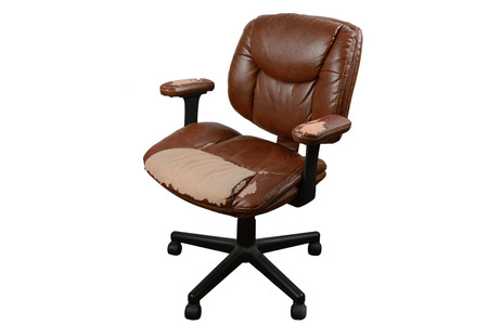 out of office: worn out office chair, torn top leather layer, isolated background