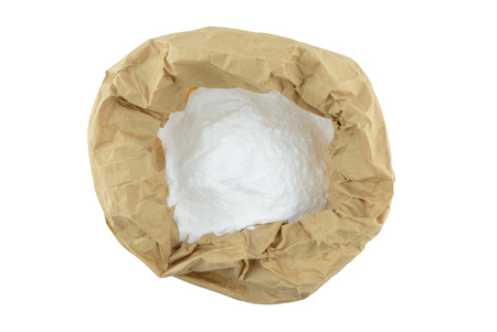 neutralizer: baking soda contained in paper bag, top view with spoon Foto de archivo