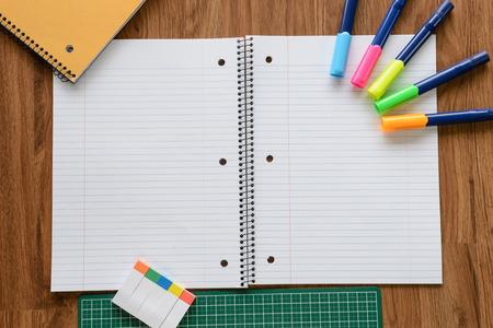 spacing: overhead shot of blank notebook equal spacing line on wood floor