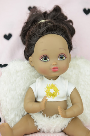 black, tan, skin tone doll in angle suit, white wings, girl