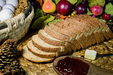 wheat toast: brown whole grain sliced bread with butter and jam, still life, close up and dark tone Stock Photo