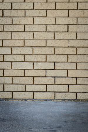 planar: orange brick wall background intersect concrete floor