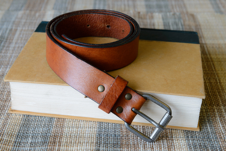clse: roll of genuine brown leather belt, men accessories Stock Photo