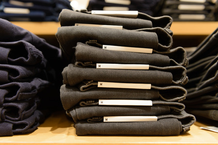 cotton  jeans: heap of jeans on shelf, m size Stock Photo