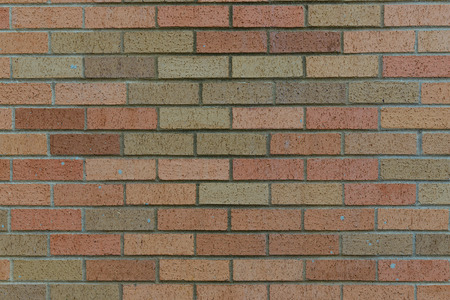 planar: background of random orange green tone brick wall, pattern, close up