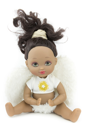 black skin tone doll in angel suit, white wings, isolate background Stock Photo