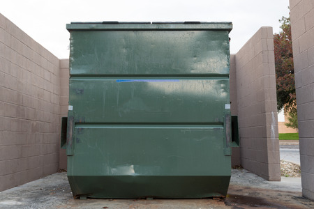 dumpster: big green dumpster isolate background Stock Photo